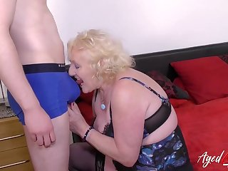 Grandma strips a young guy to screw around with him