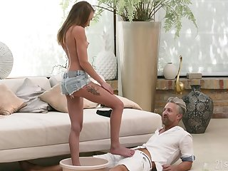 Sexy odalisque Angel Emily gives a footjob plus takes cumshots plus X-rated feet