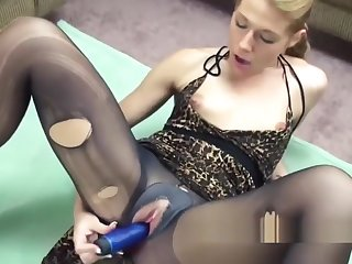 Powered hottie Lina is masturbating in her torn pantyhose